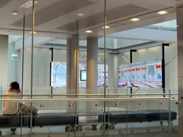The architecture inside, stainless steel, cables glass - continuous video panel along the wall