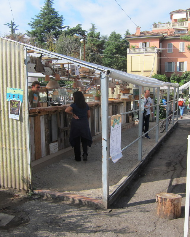 Repurposed greenhouse now houses kitchen and bar. Bar build from found objects and wood panels