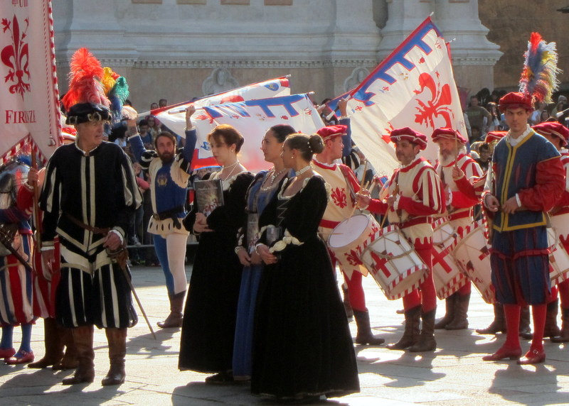 The nobility I suppose. This performing flag troupe is from Florence