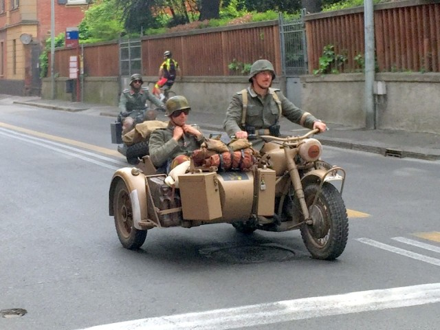 I dunno - look like Germans to me. There were a bunch of American motorcycles too.