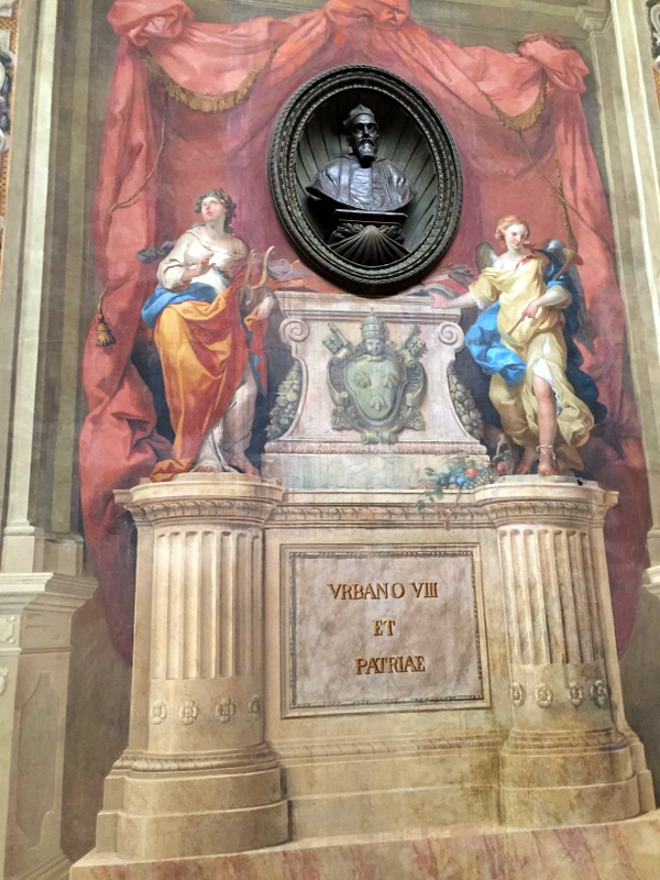 Memorial painted on the wall and niche with bust of the pope