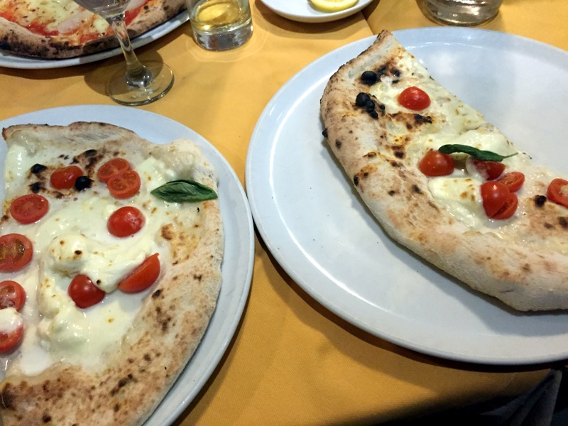The split pizza with mozzarella da bufala and cherry tomatoes